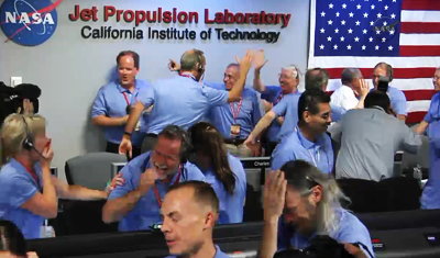 Curiosity MSL lands on Mars. Entry, Descent and Landing (EDL) team in blue shirts. Celebrate touchdown of Curiosity on Mars, hi-fives. 6 August 2012. NASA/JPL.