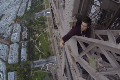 James Kingston bravely climbs the Eiffel Tower