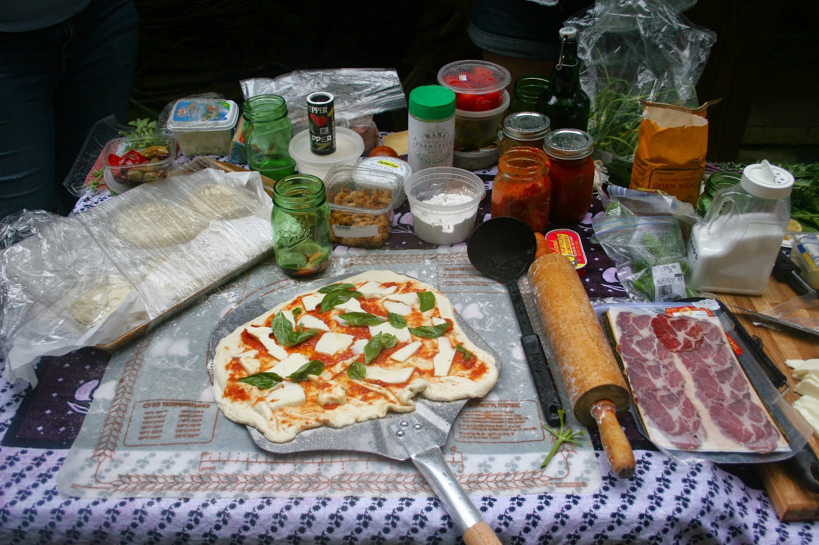 Pizza on peel with ingredients