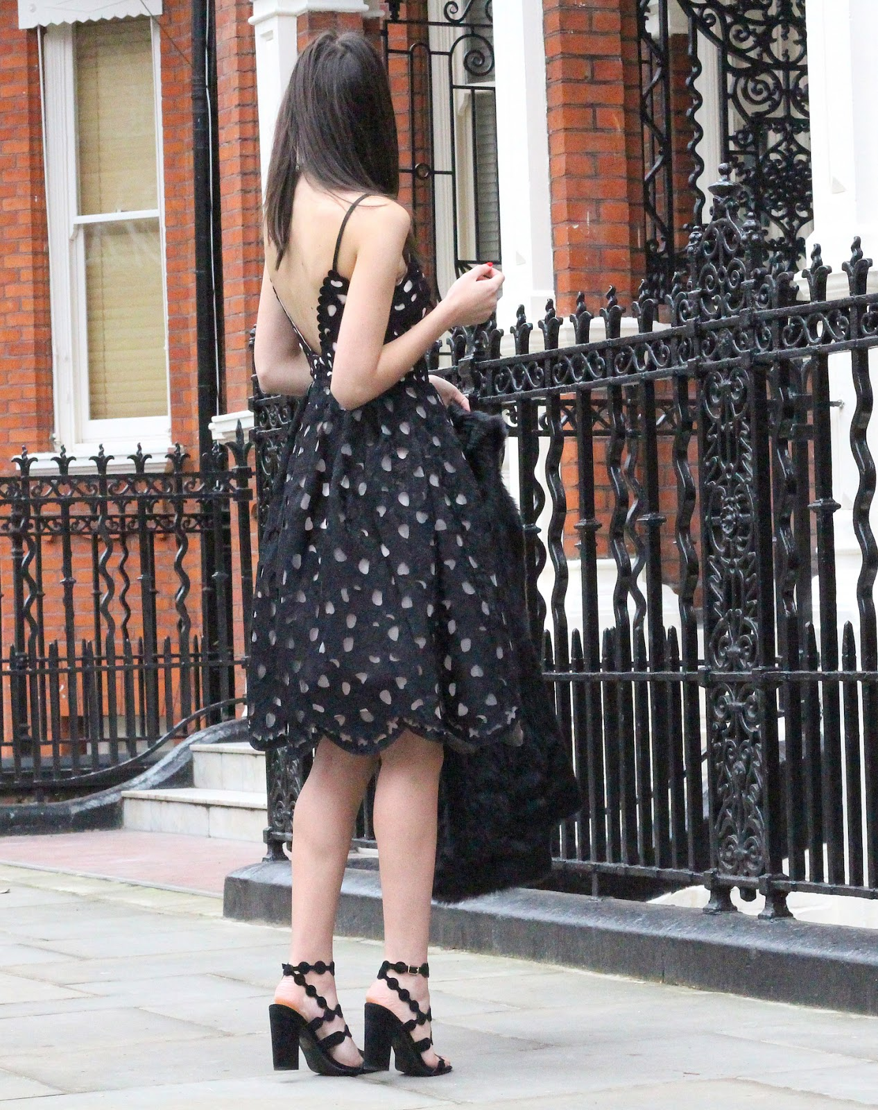 peexo wearing backless black chi chi london dress