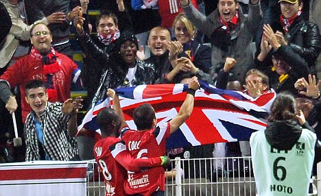 Joe Cole scores his 2nd for Lille, celebrates with a Union Jack