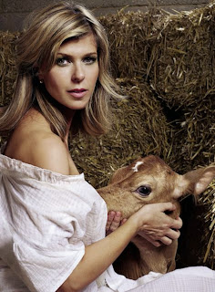 Women+breastfeeding+calf
