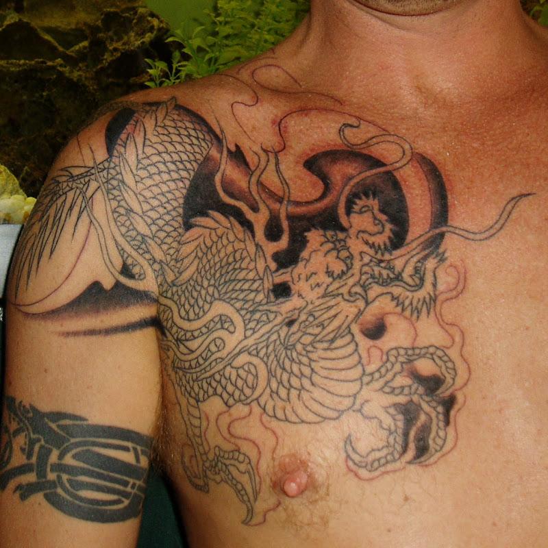 Beautiful japanese dragon tattoo Designs title=