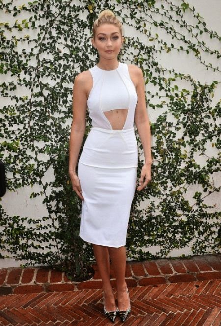 I meant she was going simple but still luxury in my opinion as the 19-year-old had picked up a few style tips in a white peekabo dress at Los Angeles, CA, USA on Saturday, January 10, 2015.
