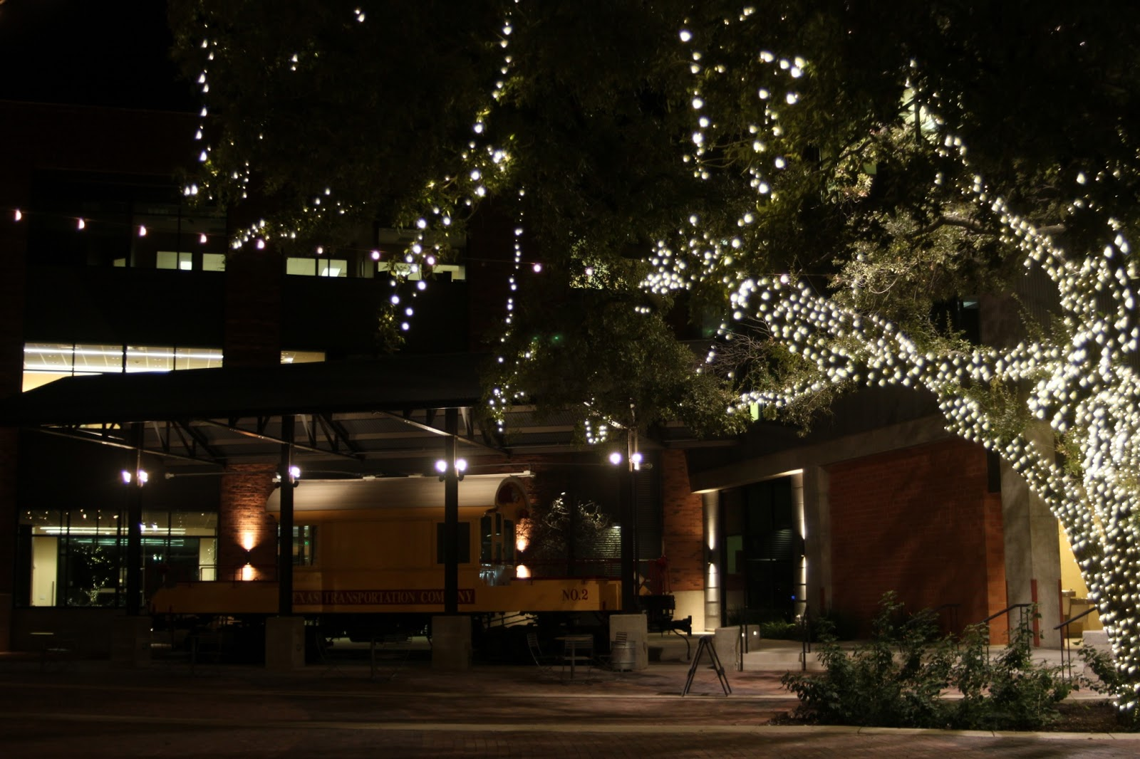 another view of the courtyard with a train car on display - Pearl Christmas Lights