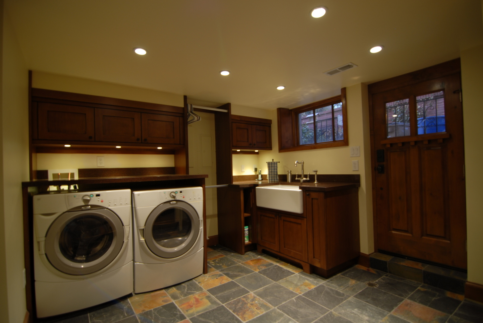 Enzy living laundry room basement in a craftsman home for Laundry room design ideas