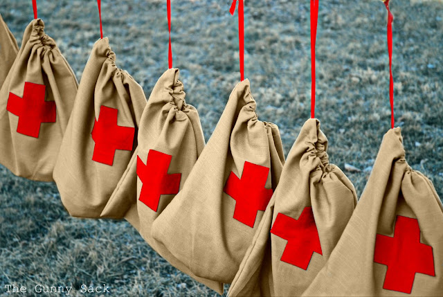 Red Cross Drawstring Bags Hanging On Line