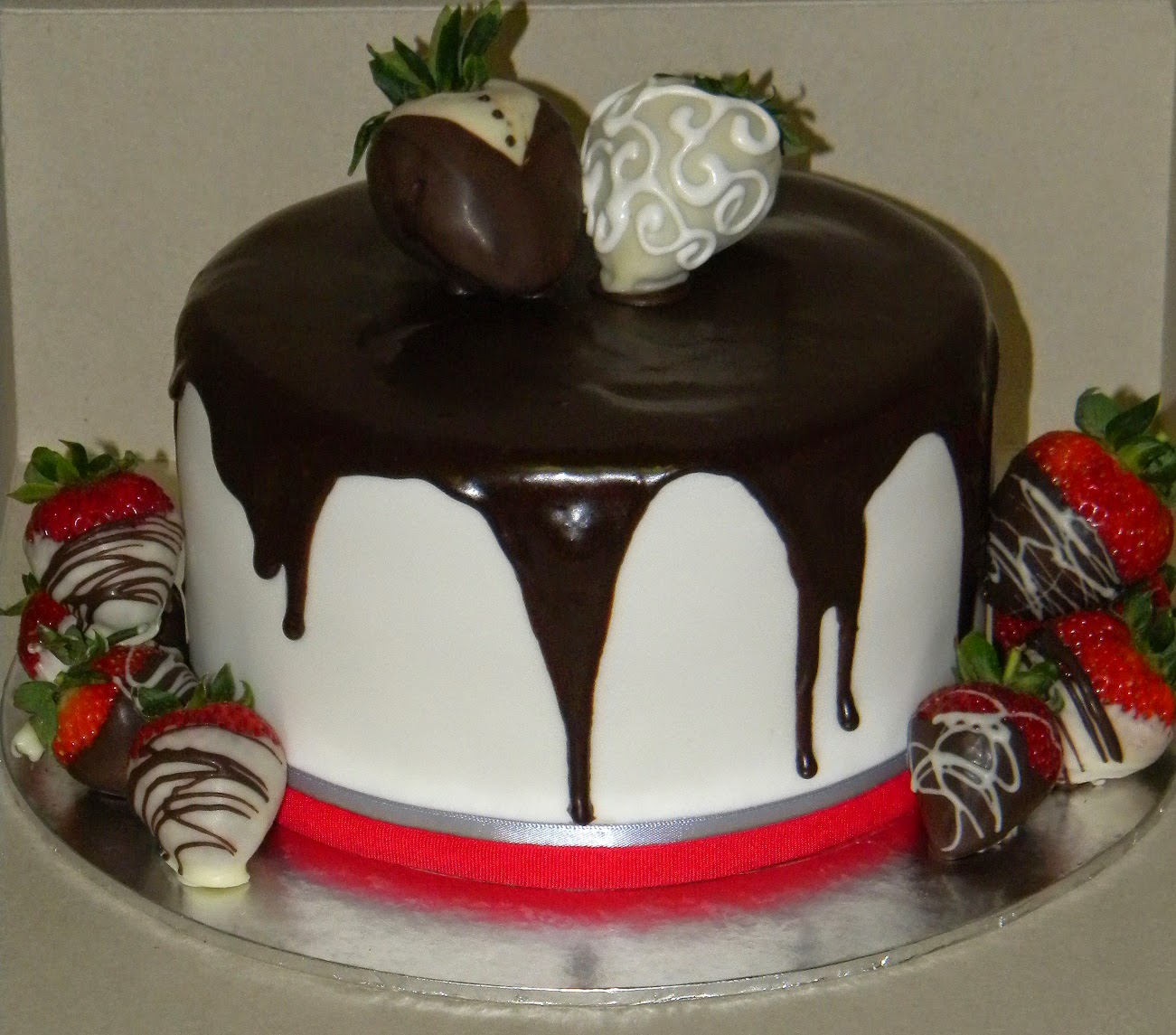 chocolate cake covered with fondant and dripped with chocolate ganache ...