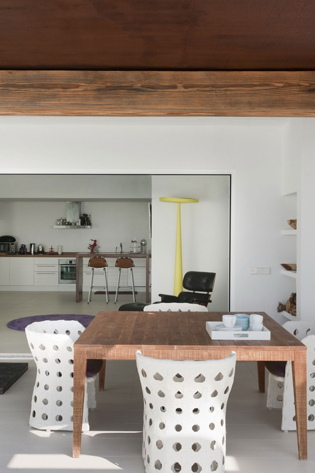 Wooden table and white chairs in the dining room