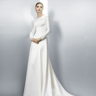 Long sleeved wedding dress, with statement back, by Jesus Peiro