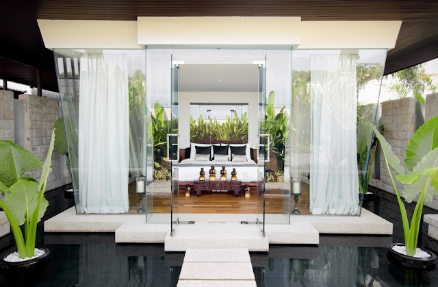 Picture of an amazing bedroom with glass walls floating on the water