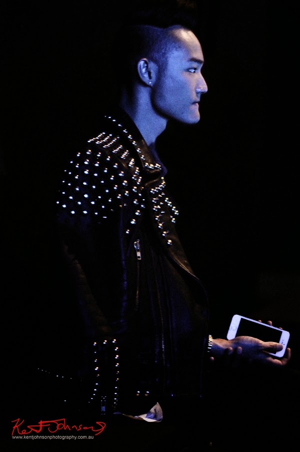 Back Row - man wearing Shiny Studed Leather Jacket at the Raffles International Showcase. MBFWA, photo by Kent Johnson.