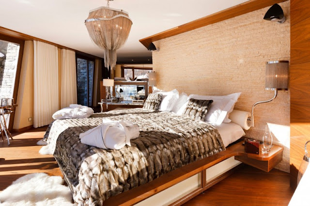Picture of large bed in the bedroom of mountain home
