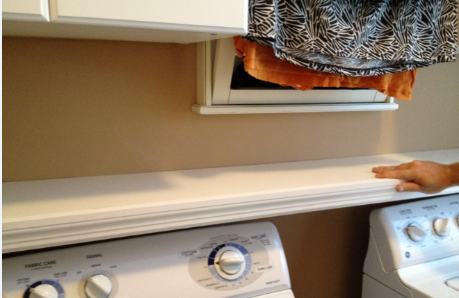 Casalupoli laundry room update over the washer dryer shelf for Shelf above washer and dryer