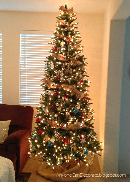 i added a yard of burlap around the bottom of the tree for the skirt here is this years finished christmas tree now it just needs some presents - Christmas Tree With Burlap