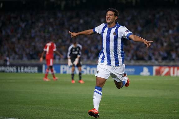 Carlos Vela of Real Sociedad celebrates scoring their second goal against Lyon