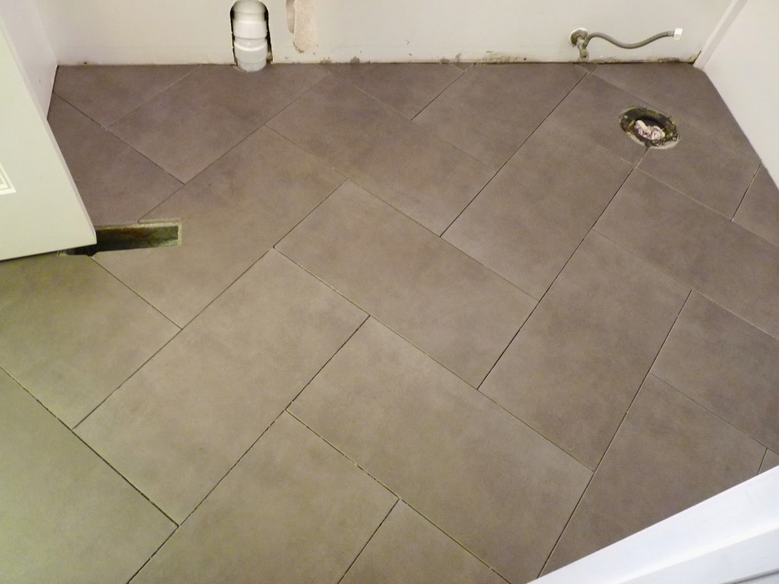 D i y d e s i g n how to install a herringbone tile floor dailygadgetfo Choice Image