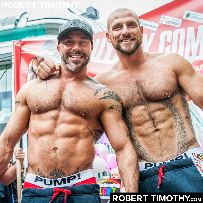 Two muscular hot guys at London World 2012. Photography by Robert Timothy