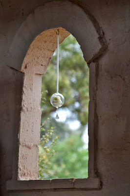 Rose decoration in arched window
