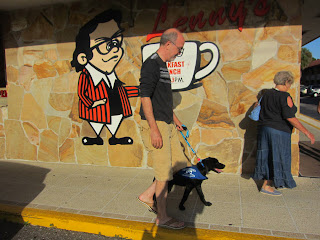 Fred and Coach walking past the Lenny's sign.