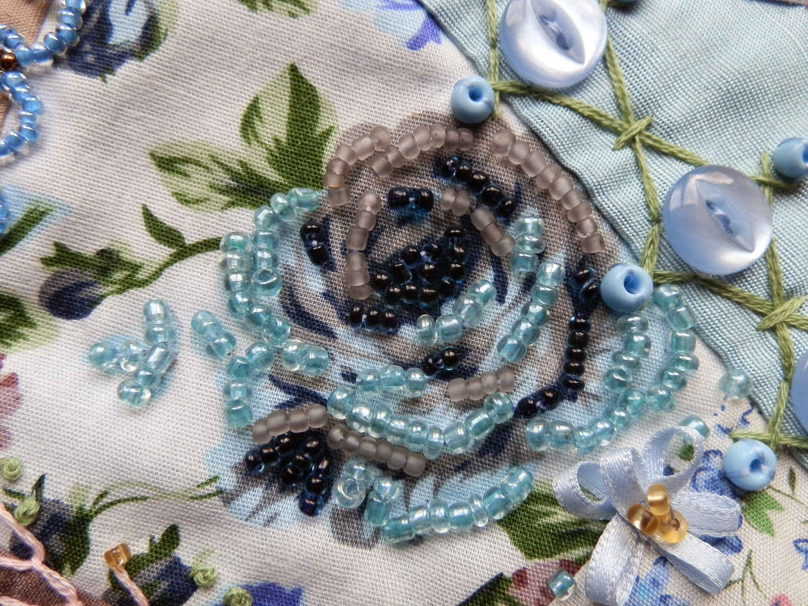 Blue and beige rose decorated with beads