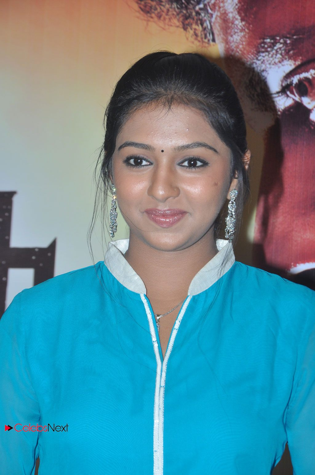 Lakshmi Menon Photos in Blue Dress at Pandiya Nadu Movie Press Meet