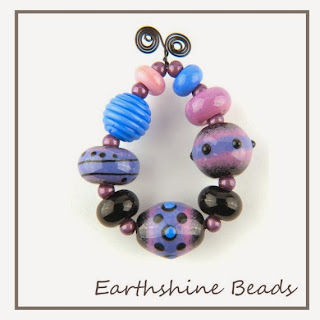 https://www.etsy.com/uk/listing/170815527/enamel-lampwork-glass-bead-set-lilac?ref=listing-shop-header-2