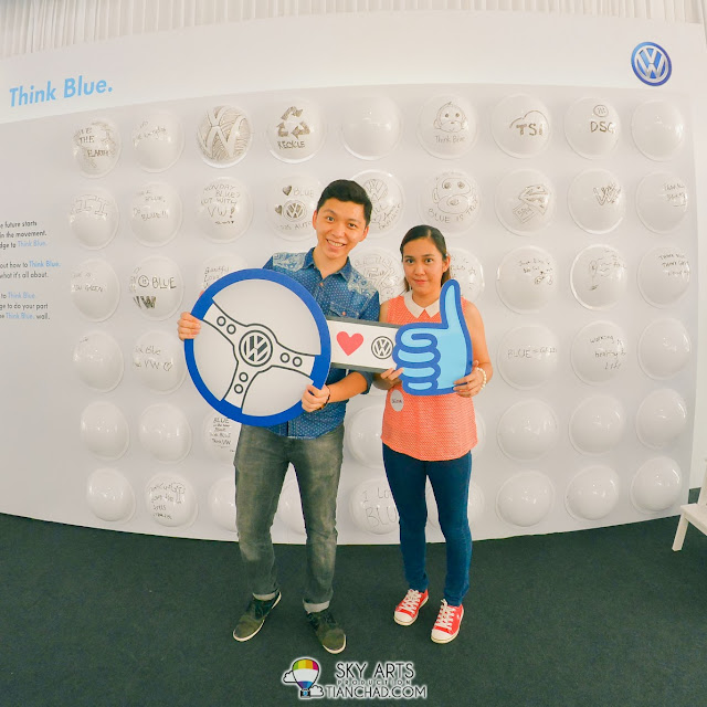 I asked the girl to help us take a photo on the Volkswagen 'Think Blue' wall too