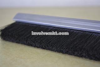 safety strip brush. escalator deflector device
