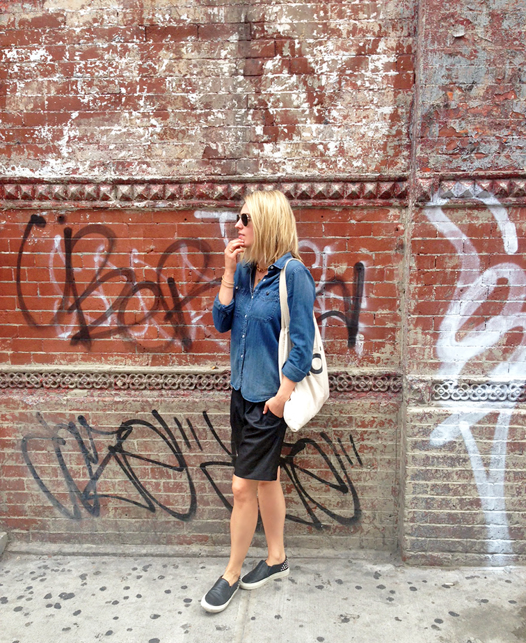 Madewell denim shirt, Tibi culottes, Sandro ANACONDA slip-on sneakers, Suburban Riot tote, graffiti brick wall, New York City