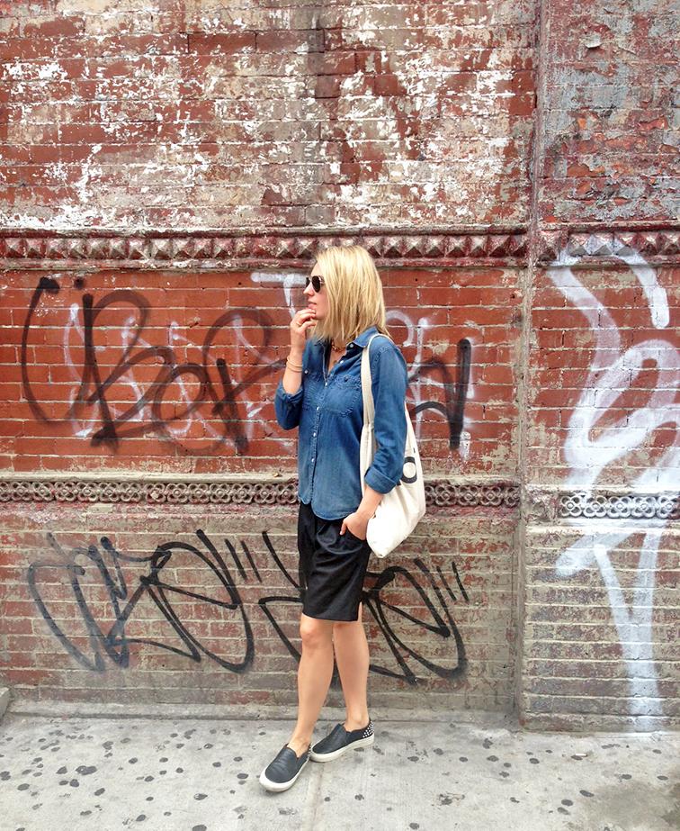 Madewell denim shirt, Tibi culottes, Sandro ANACONDA slip-on sneakers, Suburban Riot tote, graffiti brick wall, New York City