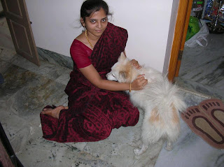 A Very beautiful and homely looking Tamil girl in saree playing with her pet dog.