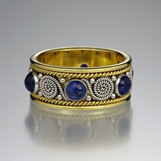 http://www.quadrumgallery.com/jewelry/product/blue-sapphire-scroll-band