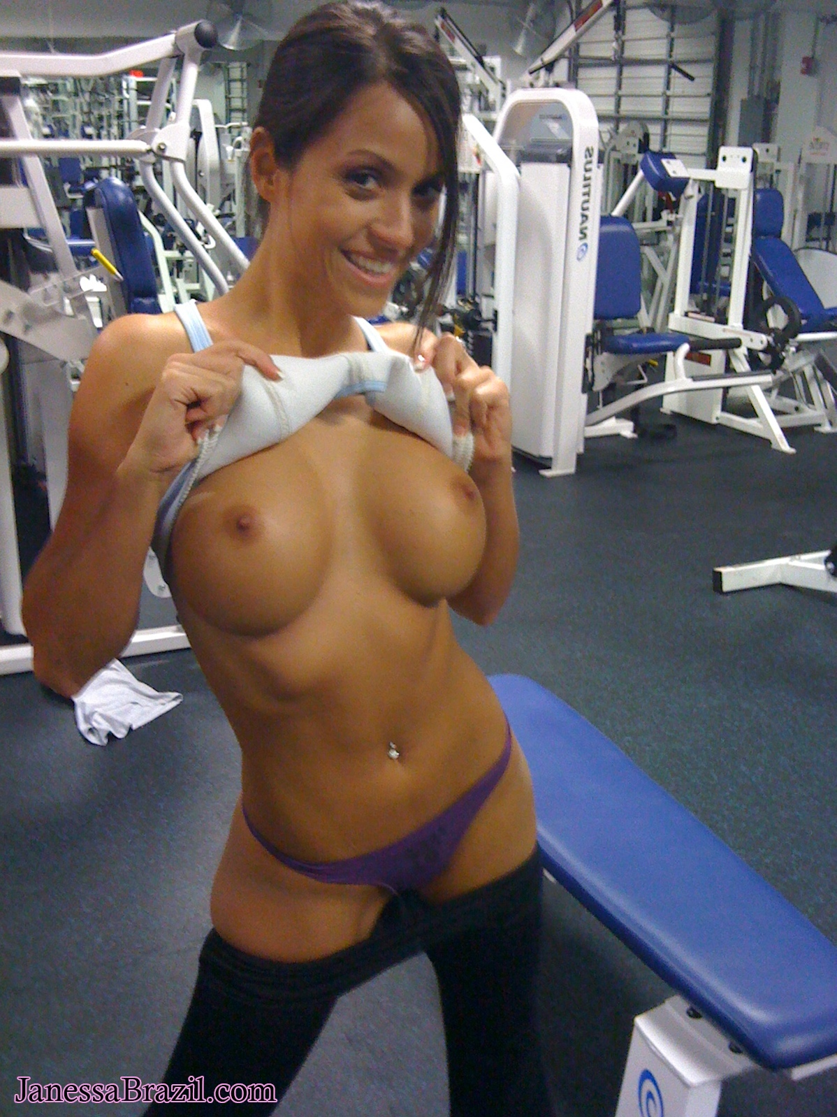 Nude small boobed woman working out