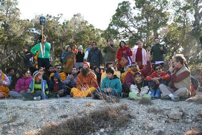 Devotees of Kripaluji Maharaj sit with Swami Nikhilanand at Barsana Hill