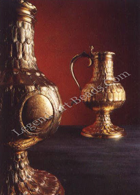 """Pair of Flagons 1664, These flagons, together with the pair of 1660, are the largest surviving examples of English flagons. They have an overall height of 20.2"""" (52cm) and together weigh 4200; (13.06kg). The circular panels on the front of the flagons are engraved with the Stuart arms."""