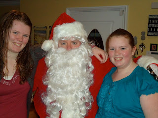 Santa Mike, flanked by his two daughters Annie and Maura.