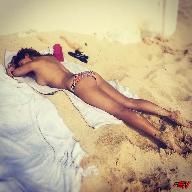 Reby Sky Topless at a Beach.
