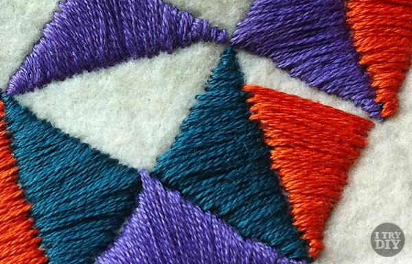 http://itrydiy.me/2014/09/embroidered-felt-bib-necklace/