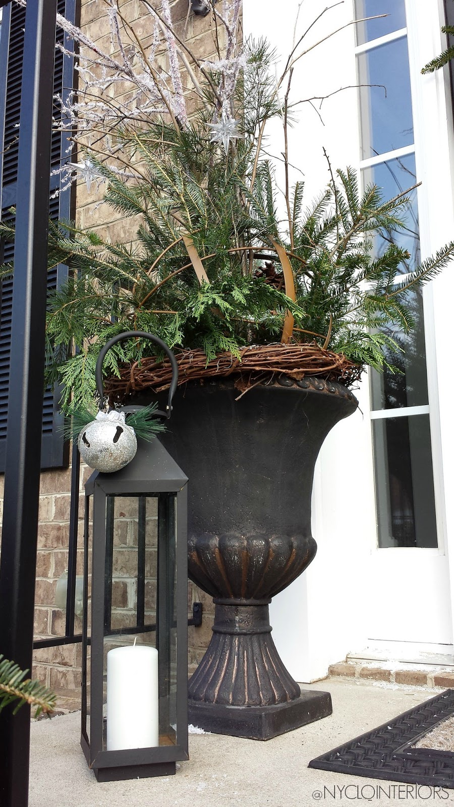 Focal point styling outdoor holiday entry with urns for Outdoor foyer ideas