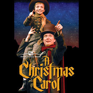 the actors playing tiny tim and his father in a christmas carol at actors theatre in louisville in period costumes