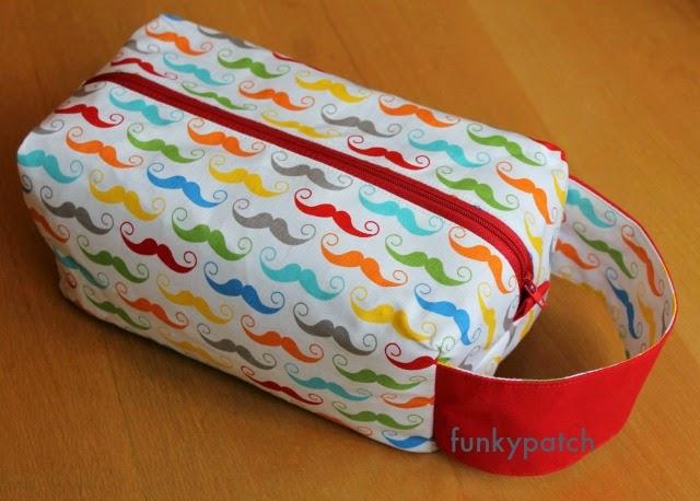 """neceser """"boxy pouch"""" con divertida y colorida tela de mostachos 100% hadmade por funkypatch"""