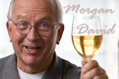 Morgan David toasting with a glass of wine