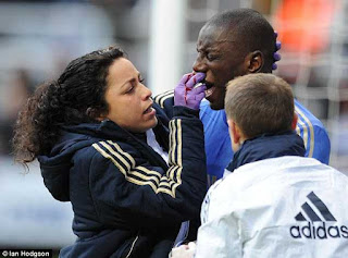 Chelsea Club Doctor Eva Carneiro treats Demba Ba for a broken nose  after being kicked in the face against Newcastle