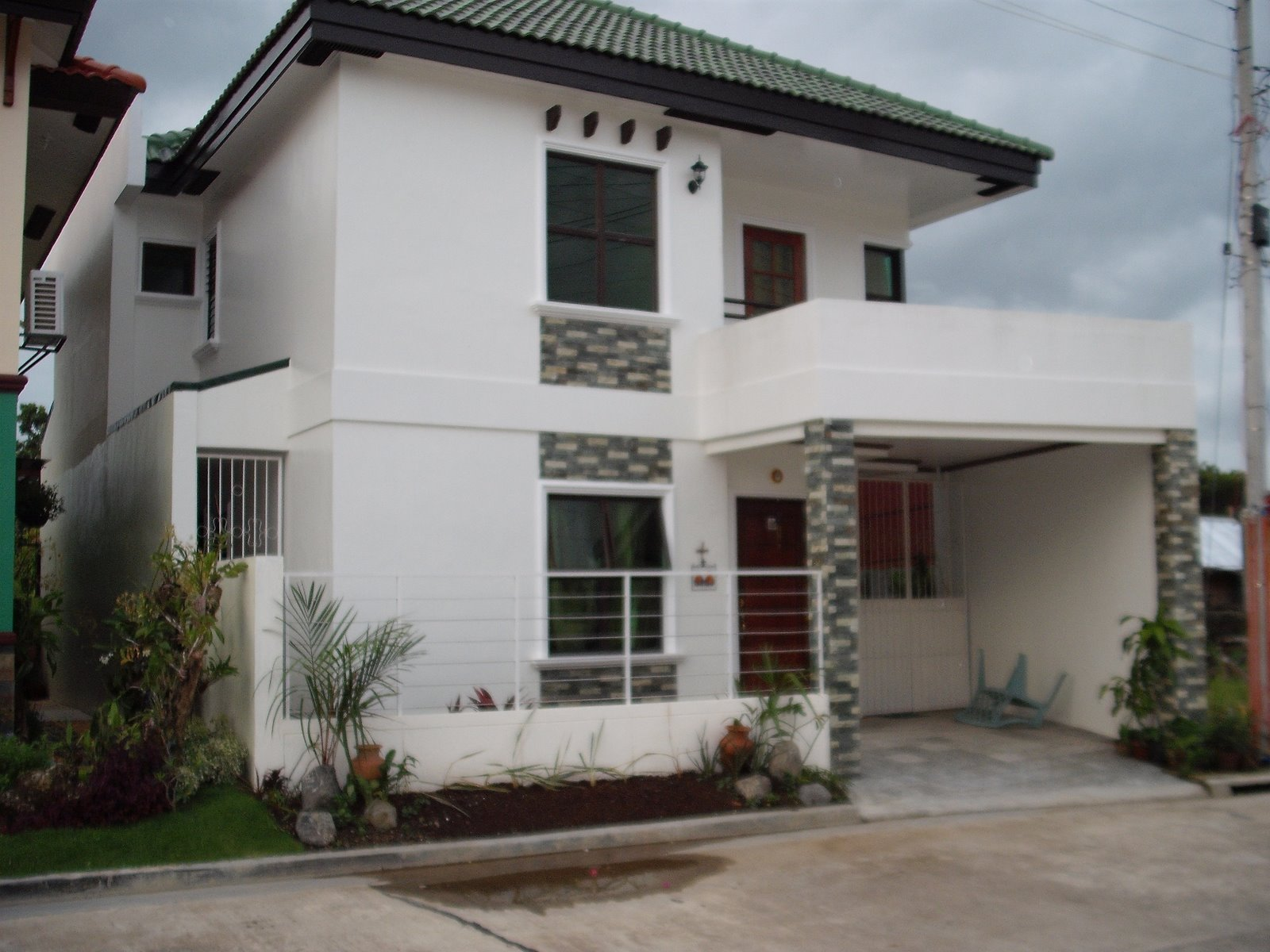 custom home designs of royal residence iloilo by pansol realty and