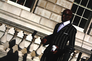 Deigh Alex wearing a pinstripe suit during london fashion week ss14
