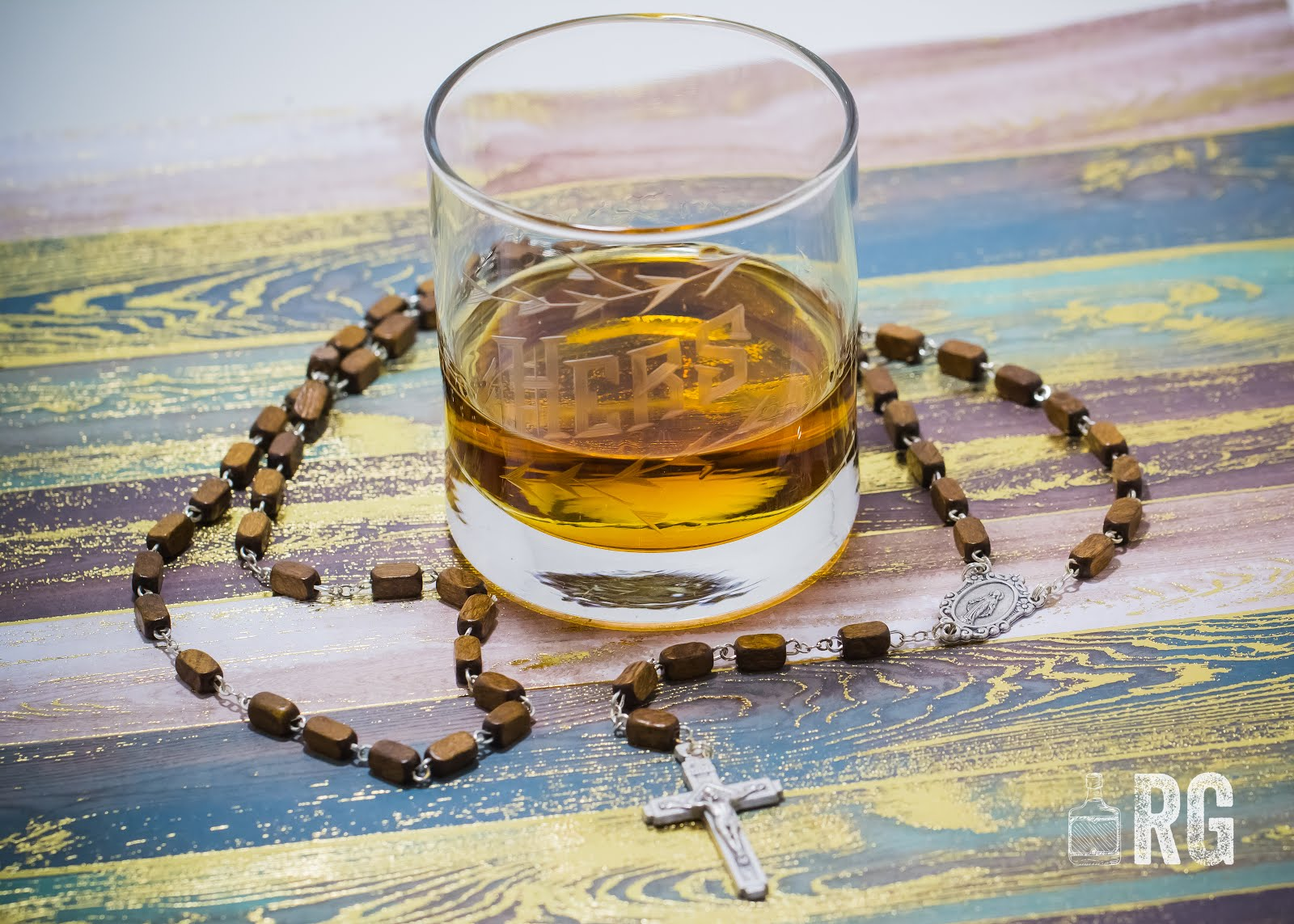 Whiskey and Rosary by Meagan Montez