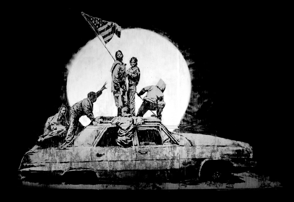 Banksy image: raising the flag not over Iwo Jima but over an abandoned auto