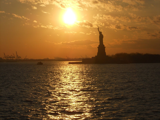 New York CIty Statue of Liberty sunset boat