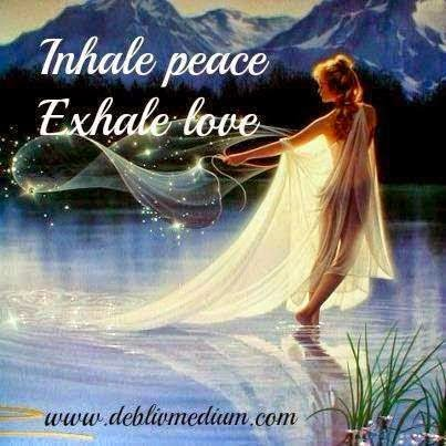 """Inhale peace, exhale love."" Picture of woman throwing a glittering fishnet on a lake with mountains in the background. www.deblivmedium.com"